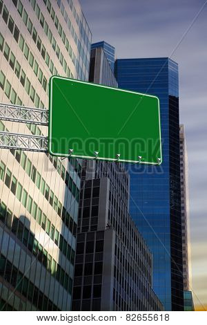 The word a new you and green billboard sign against low angle view of skyscrapers