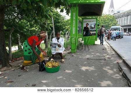 African Black Man And Woman At Public Transport Stop.