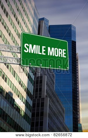 The word smile more and green billboard sign against low angle view of skyscrapers