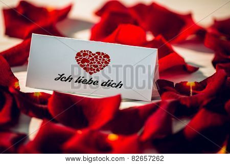 ich liebe dich against card surrounded by petals