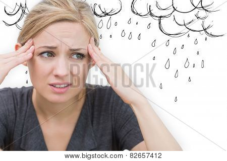 Woman with headache against rain clouds