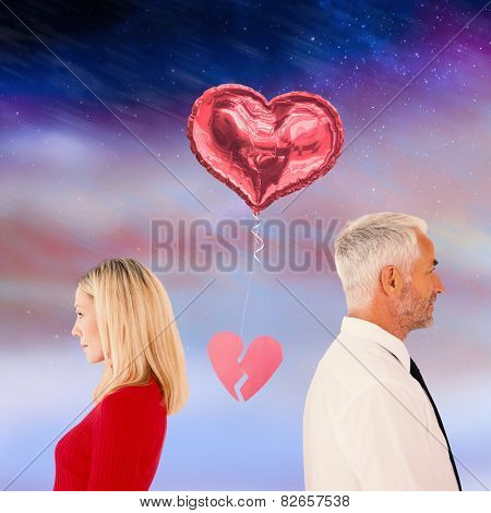 Couple not talking with broken heart between them against aurora night sky in purple