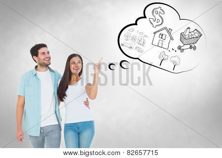 Happy casual couple walking together against grey vignette
