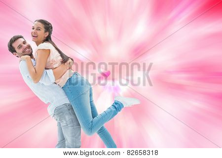 Attractive young couple hugging each other against digitally generated girly heart design