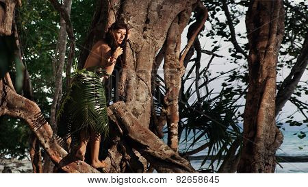 Indigene Woman In The Palm Skirt On The Tropical Forest And Sea Background