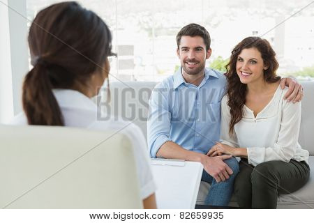 Psychiatrist listening her smiling patients in the office