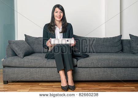 Smiling Businesswoman Sitting Holding A Binder