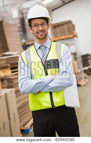 Portrait of worker wearing hard hat in the warehouse