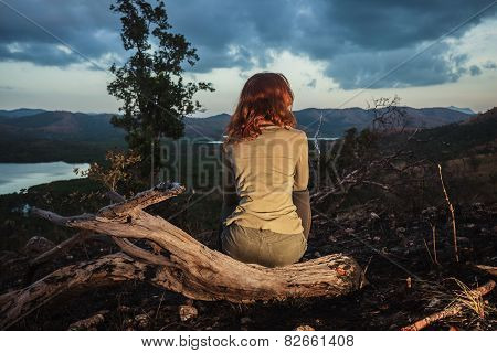 Woman Sitting On A Burned Hill