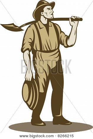 Prospector mineiro ou garimpeiro com pá