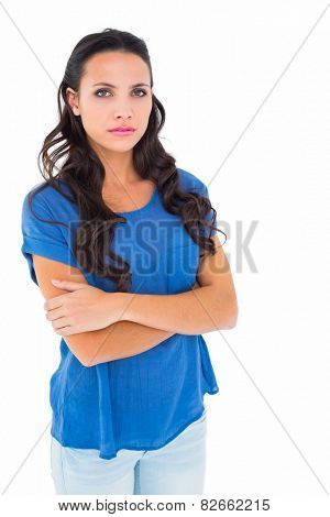 Angry brunette frowning at camera on white background