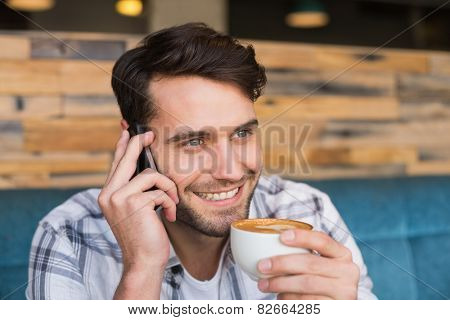 Young man having cup of coffee at the cafe