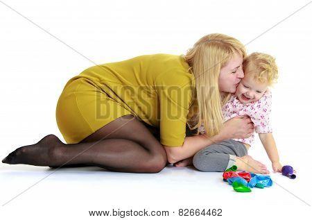 happy mother embracing his beloved daughter.