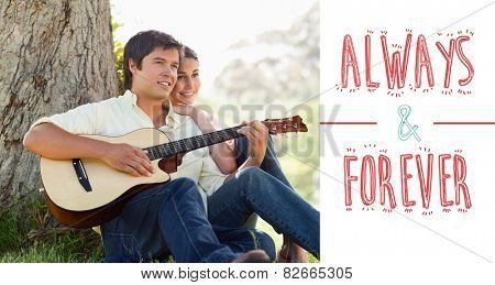 Man playing the guitar while looking into the distance with his friend against always and forever