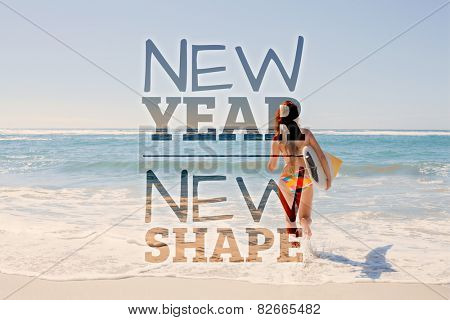 Beautiful surfer girl walking to the sea with her surfboard against new year new shape