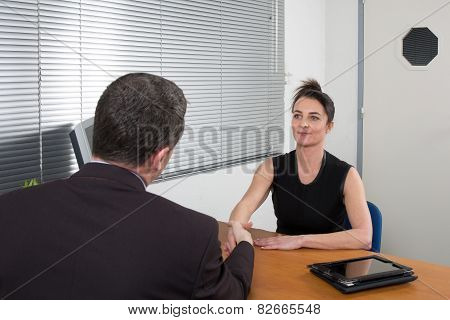 Business People Talking Together At Desk - Adviser And Customer