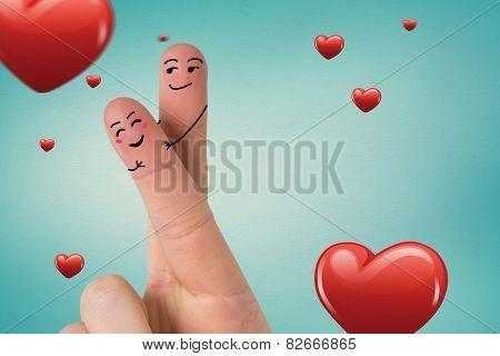 Fingers crossed like a couple against love heart pattern