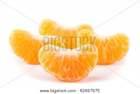 Slice of Clementine with more slices on background, on white