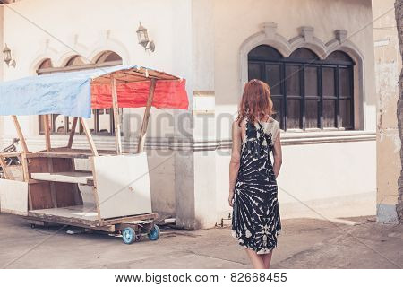 Young Woman Walking In A Small Town In Developing Country