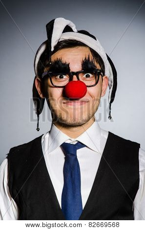 Funny businessman with clown nose