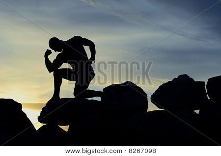 Silhouette Of A Bodybuilder On The Rocks