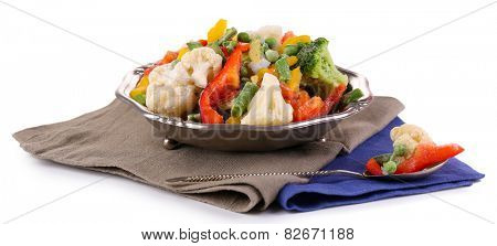 Frozen vegetables in bowl on napkin, isolated on white