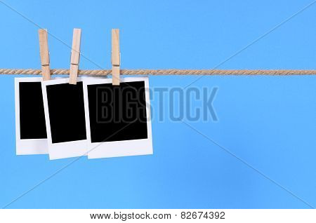 Blank Photo Prints On A Washing Line