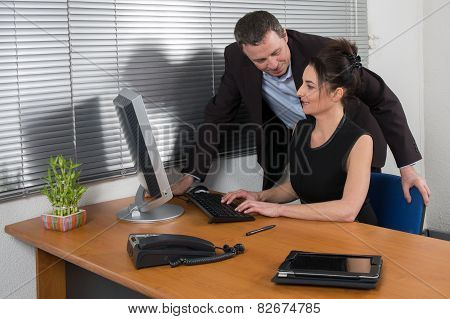 A Director Of Company Flirting With His Attractive Secretary