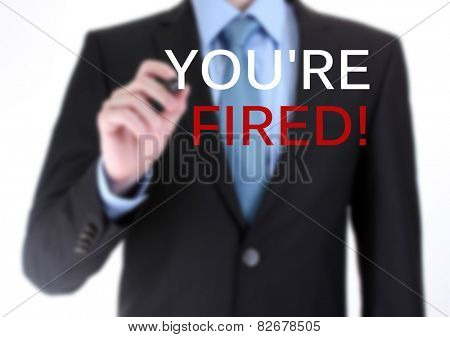 Businessman writing You're fired on screen isolated on white