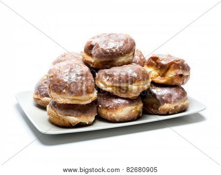 Polish donuts on plate shot on white