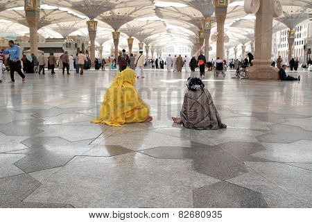 Women Sitting In The Courtyard Of The Mosque Of The Prophet In Medina, Saudi Arabia