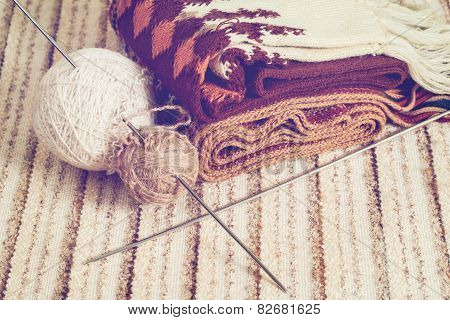 Knitting Needles And Yarn On Rustic
