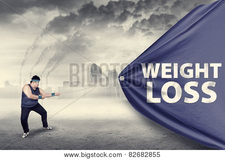 Fat Man Pulling A Weight Loss Banner