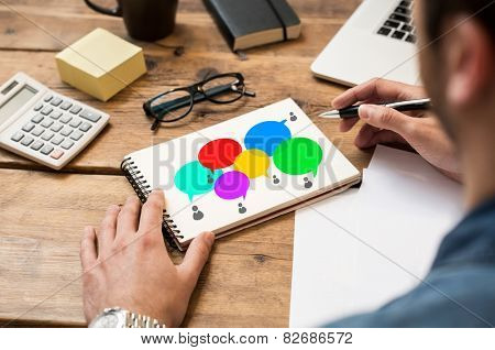 Businessman drawing a social network and diversity concept sketch