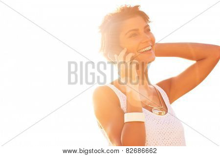 Portrait Of Beautiful Young Woman Talking On Cellphone At Sunset