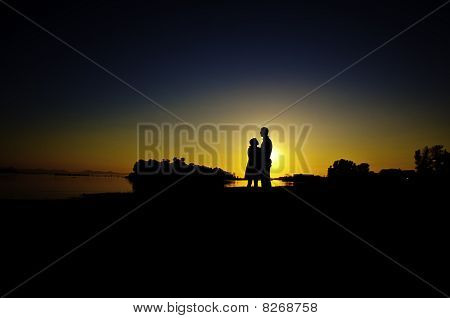 Couple In Sunset By The Shore