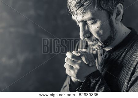 man closed his eyes to pray