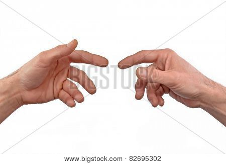 Two hands approaching,touching fingers.