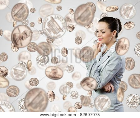 Portrait of businesswoman and many cent coins around