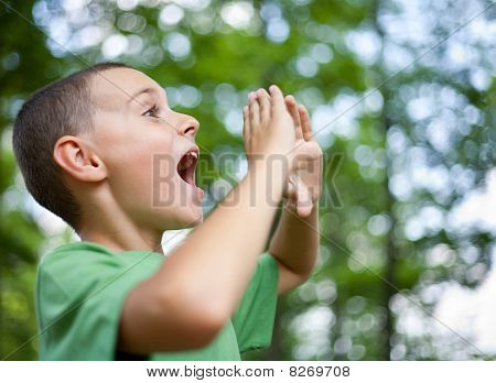 Little Boy Shouting In The Forest