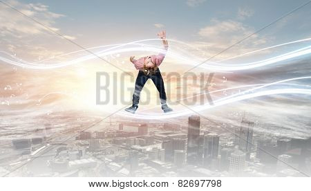 Young guy in casual evading from light rays