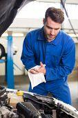 foto of hoods  - Mechanic examining under hood of car at the repair garage - JPG