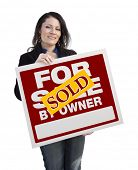 stock photo of hispanic  - Hispanic Woman Holding Sold For Sale By Owner Real Estate Sign Isolated On White - JPG