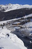 foto of italian alps  - A small river running through the valley at Livigno in the Italian Alps on a bright sunny day in January