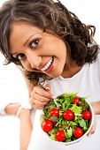 stock photo of youg  - Youg woman eating healthy salad isolated on white background - JPG