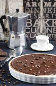 picture of tort  - Chocolate and coffee tart with salted caramel on a dark wooden background