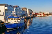 foto of fjord  - White and blue fishing boat at the wharf repair - JPG