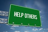 pic of helping others  - The word help others and green billboard sign against cloudy sky with sunshine - JPG