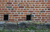 stock photo of basement  - Wall with small windows at the basement of a church building - JPG