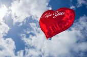 pic of cursive  - i love you against bright blue sky with clouds - JPG